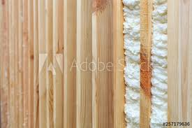 An Example Of Filling The Gap Between Vertical Wooden Planks With Building Foam Buy This Stock Photo And Explore Similar Images At Adobe Stock Adobe Stock
