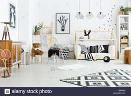 Kids Room With House Bed Dresser Chair And Bookshelf Stock Photo Alamy