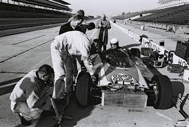Dave MacDonald runs Mickey Thompson's Ford powered 83 car in the 1964 Indy  500