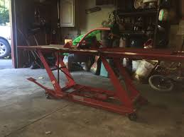 central hydraulic motorcycle lifts for