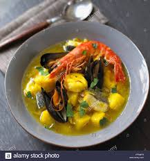 Seafood soup in bowl with saffron and ...