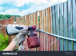 Painting Metal Fence Spray Man Paints Technology Stock Image 1469255267
