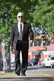 Adult Entrepreneur Portrait Wearing Tie Walking On Sidewalk Stock ...