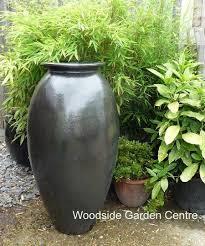 tall matt black glazed roman jar vase