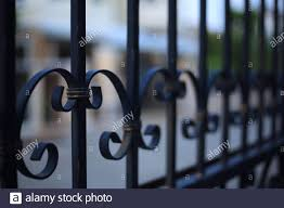 Lock Down Stay At Home And Business Closed Concepts Close Up Image Of Fence Made Of Iron Cast Metal Rods Stock Photo Alamy