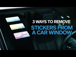 remove a sticker from a car windshield