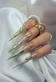 gold sti sculpted gel nails with