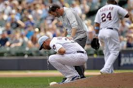 YUCK: Brewers pitcher Adrian Houser pukes TWICE as he pitches ...