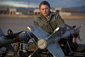 Airman 1st Class Ashley Hill conducts preload checks on an AIM-9 ...