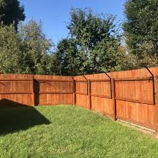 The Existing Fence Dog Containment Arms When Coupled With A Welded Wire Or Strong Poly Fence Will Secure Your 4 Or Higher F Backyard Fences Backyard Dog Fence