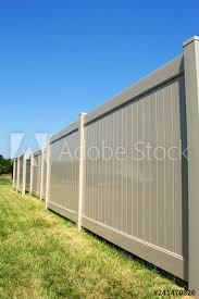 Tan Colored Vinyl Fence In Perspective With Blue Sky In The Background Buy This Stock Photo And Explore Similar Images At Adobe Stock Adobe Stock