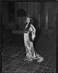 Model Priscilla Lawson in satin and fur negligee, Times Fashion Show, Los  Angeles, 1936 — Calisphere