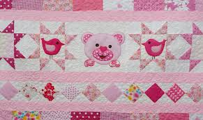 pink patchwork quilt nursery bedding