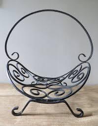black wrought iron firewood holder