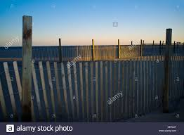 A Windbreak Fence On The Beach At Sunset In Ocean City Maryland Usa Stock Photo Alamy