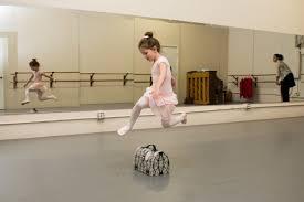 Children dance through summer camp - Addie Miller performs a leap ...