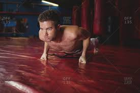 karate player doing push up in fitness