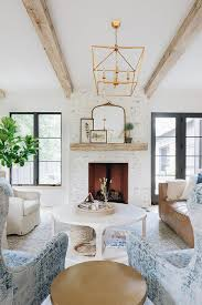 white painted brick fireplace with gilt