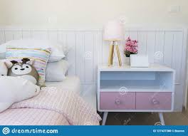 Pink And Blue Blanket With Creative Pillows On Bed In Colorful Kids Room Stock Photo Image Of Coverlet Lamp 127437380