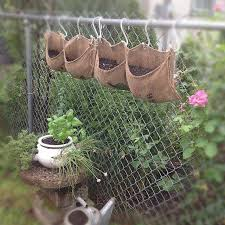 Chain Link Fence Gardening I Wonder If S Hooks Would Work With Window Boxes To Pretty Up The Front Corner Chain Link Fence Fence Plants Green Fence