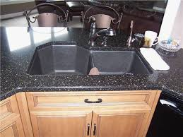 a sink with laminate countertop