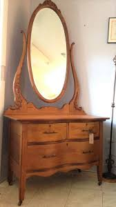 oak dresser with tall oval mirror