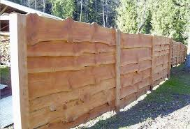 Live Edge Siding Live Edge Boards Make An Interesting Fence Or Siding Material Boards Edge Fence Interesting In 2020 Natural Fence Wood Fence Diy Garden Fence
