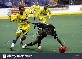 Cleveland Force's Adauto Neto (L) triees to stay clear of Philadelphia  Kixx's Gary Brooks who falls