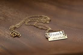 horizontal rectangle necklace between