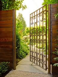 Accordion Dog Gates With Traditional Landscape And Bougainvillea Brick Paving Brick Wall Climbing Plant Entry Gate Garden Gate Hedge Neutral Colors Path Planters Side Yard Stucco Walkway Wooden Gate Finefurnished Com