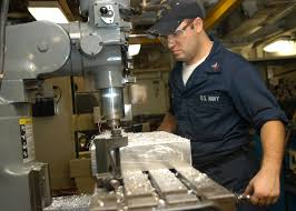 File:US Navy 040830-N-7568S-003 Machinery Repairman 2nd Class Wesley  Reynolds from Huntsville, Ala., mills a soft composite metal plate for an  F-14 Tomcat assigned to the Jolly Rogers of Fighter Squadron One Zero
