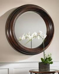 cristiano round dark wood mirror