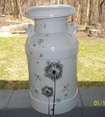 Refurbished Milk Can Primed And Painted Adorned With Dollar Store Wall Decals Painted Milk Cans Milk Can Decor Old Milk Cans
