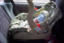 putting your newborn in a car seat 95
