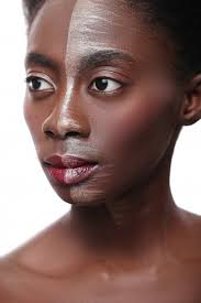 black woman with half face on makeup