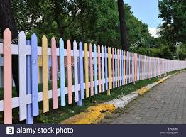 Wooden Fence Painted In Bright Colors Stock Photo Alamy