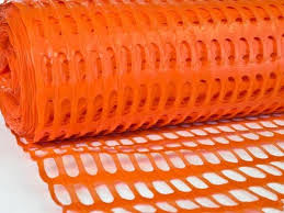 Orange Plastic Netting As Safety Fence In Traffic Control
