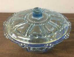 light blue glass covered candy dish