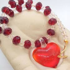 red glass heart pendant necklace on a