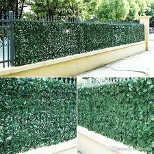 2020 Artificial Topiary Hedge Plant Privacy Fence 3m 5m Green Leaves Fake Ivy Wall Garden Backyard Balcony Decoration From Happinessker 63 72 Dhgate Com