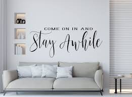 Stay Awhile Wall Decal Welcome Entryway Decal Front Door Etsy In 2020 Living Room Decals Front Door Decal Kitchen Wall Decals
