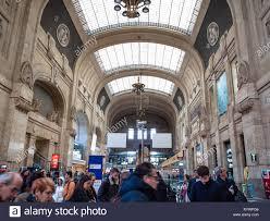 MILAN, ITALY - FEBRUARY 24, 2019: passengers inside Stazione ...