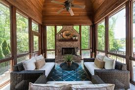 glassed in porch with fireplace in