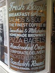 Pin By Bre Winn On That S The Thing Dear Window Graphics Cafe Window Restaurant Signage