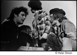 Abbie Hoffman (left) talking with other protesters - Digital Commonwealth