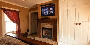 when to mount a tv over a fireplace