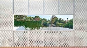 Bonba Studio Encases Extension In Barcelona In White Metal Mesh