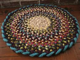 cerise pink wool round braided rug