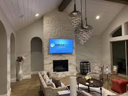 75 q7f 4k tv over stone fireplace