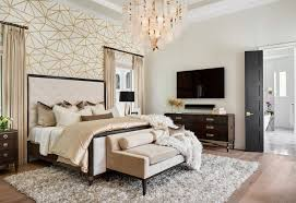 gold and white wallpaper feature wall